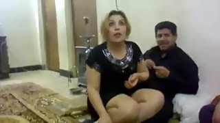 An iraqi man and his wife at a party