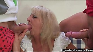 Blonde granny in hot orgy threesome